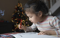 Little girl with sketch block at Chrismas time - AZF00040