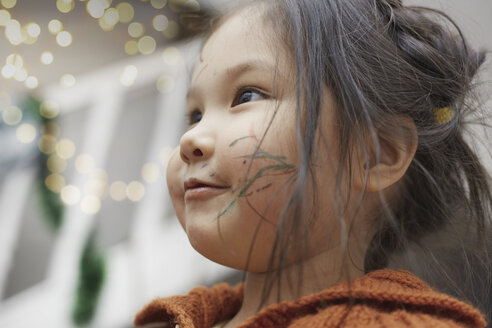 Portrait of little girl with paint strokes on her cheek - AZF00052