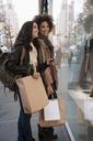 Women window shopping on city street - ISF17157