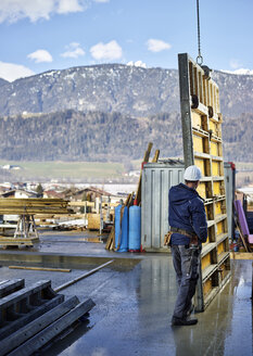 Construction worker positioning plywood - CVF00990