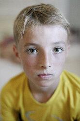Portrait of blond boy wearing yellow t-shirt - KMKF00435