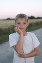 Portrait of blond boy at evening twilight - KMKF00438