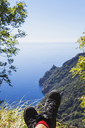 Italy, Liguria, Portofino Peninsula, Hiker resting in the mountains - GWF05598