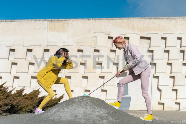 Two alternative friends golfing - AFVF01053