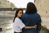 France, Paris, young couple in love at river Seine - AFVF01108