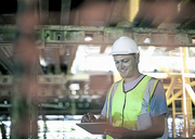 Construction worker using tablet computer - ISF17372