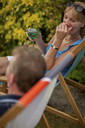 Couple having wine together outdoors - ISF17453
