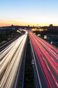 Germany, Baden-Wuerttemberg, Stuttgart, Autobahn A8 in the evening, light trails - WDF04769