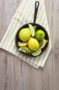 Fresh lemon in pan, overhead view - GIOF03987