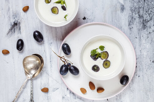 Ajo Blanco, white gazpacho, spanish cold soup, almonds and blue grapes, overhead view - SBDF03706