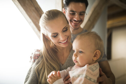 Happy young parents spending time at home with their baby girl - AWF00132