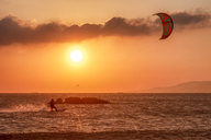 Spain, Andalucia, Tarifa, kite surfer at sunset - SMAF01092