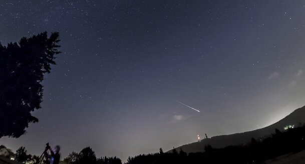 Germany, Hesse, Hochtaunuskreis, Bright Perseid Meteor burning out over Taunus Ranges - THGF00046