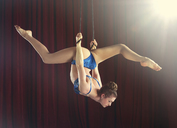 Female aerialist performing splits on ropes - ISF18016