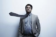 Studio portrait of businessman with flyaway tie - ISF18109