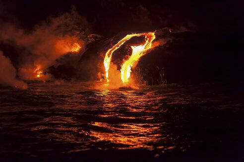 Lava flow into sea at night, Kilauea volcano, Hawaii - ISF18211