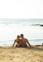 Young couple kissing on beach, Sunset Cliffs, San Diego, California, USA - ISF18471