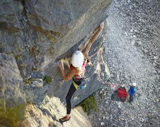 Austria, Innsbruck, Martinswand, woman climbing in rock wall - CVF00998