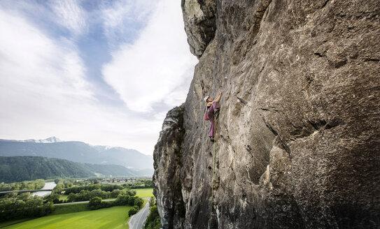 Austria, Innsbruck, Martinswand, woman climbing in rock wall - CVF01001