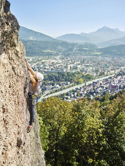 Austria, Innsbruck, Hoettingen quarry, woman climbing in rock wall - CVF01007