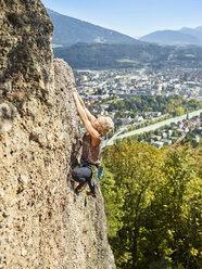 Austria, Innsbruck, Hoettingen quarry, woman climbing in rock wall - CVF01010