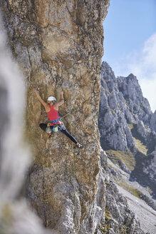 Austria, Innsbruck, Nordkette, woman climbing in rock wall - CVF01019