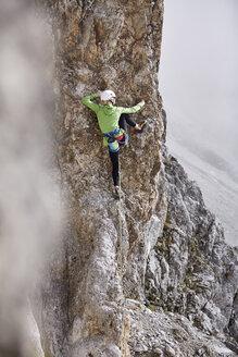 Austria, Innsbruck, Nordkette, woman climbing in rock wall - CVF01022