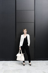 Fashionable businesswoman wearing black and white clothes - GIOF04016
