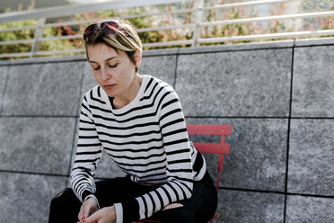 Portrait of woman having a rest outdoors - GIOF04043