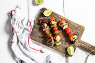Grill skewers with grilled chicken, tomato, bell pepper and zucchini on chopping board - SBDF03709