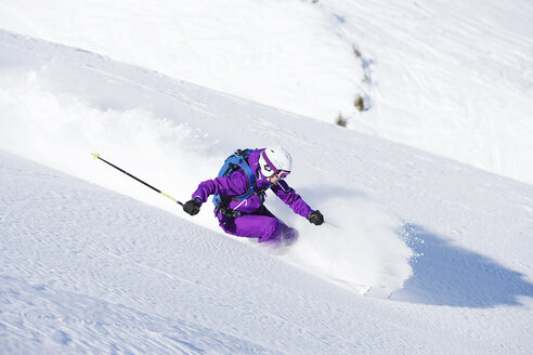 Female skiing downhill at speed - ISF18547