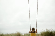 Female toddler on beach swing - ISF18592