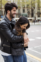 Spain, Barcelona, happy young couple hugging on the street - MAUF01544