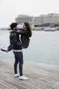 Spain, Barcelona, happy young couple having fun at the coast - MAUF01553