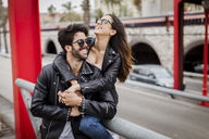 Spain, Barcelona, happy young couple in the city - MAUF01583