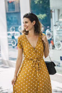 Beautiful woman wearing yellow dress with polka dots - KKAF01276