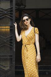 Beautiful woman wearing yellow dress with polka dots - KKAF01285