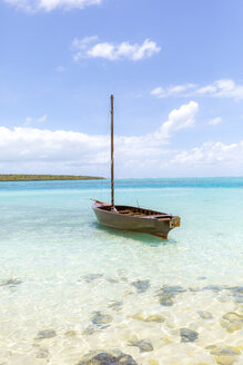 Mauritius, Grand Port District, Pointe d'Esny, sailing boat in turquoise water, blue sky and clouds - MMAF00425