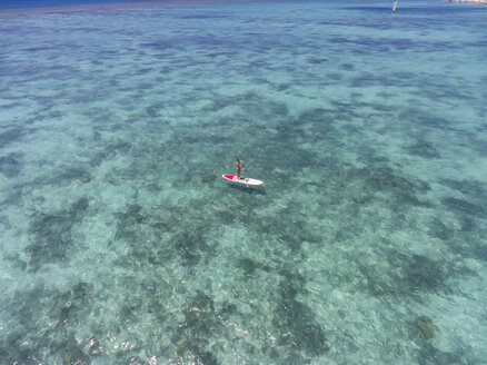 Mauritius, young woman on stand up paddling board - MMAF00443