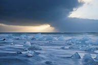 Icebergs on beach with stormy sky, Jokulsarlon, Iceland - ISF19015