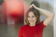Portrait of smiling woman wearing red shirt - PNEF00792