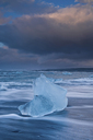 Icebergs on beach and stormy sky, Jokulsarlon, Iceland - ISF19118