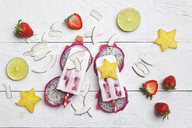 Homemade exocitic fruits, coconut ice lollies, starfruit, lime, dragonfruit, dryed coconut chips and strawberries - GWF05623