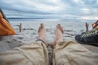 Feet of man, lying on the beach - VPIF00419