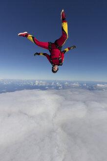 Female skydiver free falling upside down - ISF19163