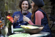 Couple having wine together outdoors - ISF19322