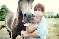 Grandmother and toddler with horse - ISF19391