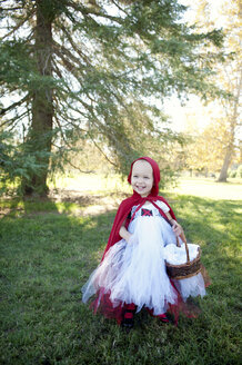 Female toddler in woods dressed up in red riding hood costume - ISF19409