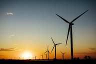 Spain, wind farm at sunset - OCAF00337