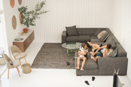 Mother, son and daughter on a sofa. - MINF03826